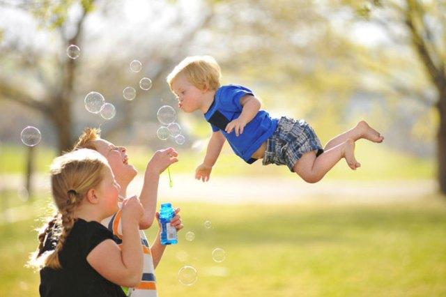 Bebê-com-Síndrome-de-Down-voando-16-719x479